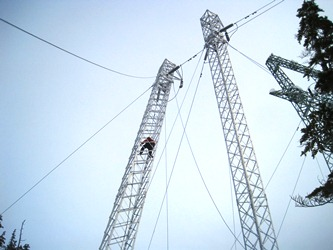 AEL&P lineman Eric Nielsen climbs the leaning tower. (Photo courtesy Alaska Electric Light & Power)
