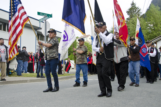 The Native Alaska Veterans started the parade to Centenial Hall.