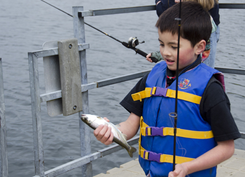 Gabe Cheng, 7, holds his third fish of the morning.
