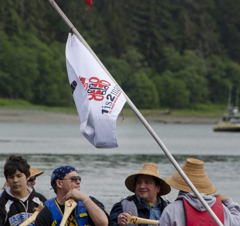 The lead canoe displays the flag for the 1 is 2 many program. The canoe trip was part of a suicide awareness campaign.