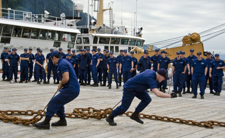Teams pulled chains across the dock as part of the annual Coast Guard Buoy Tender Round-Up Olympics on July 18, 2012. (Photo by Heather Bryant/KTOO)