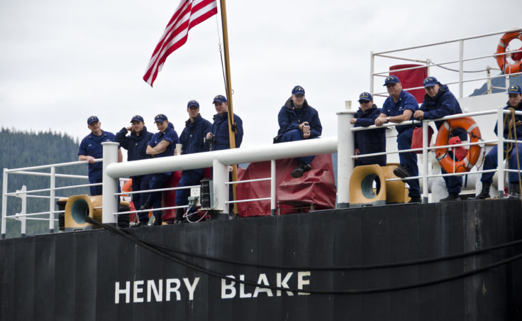 The crew of the Henry Blake watch the swimming competition.