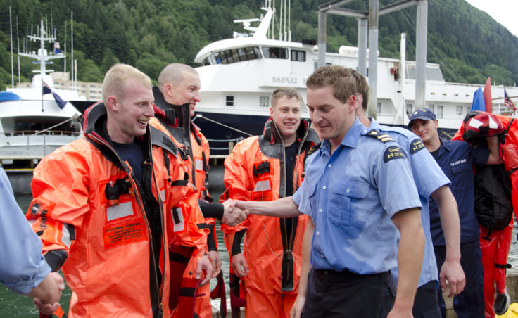 Teams congratulate the team from the Canadian Coast Guard Vessel Bartlett. The team had a winning time of 5:39.