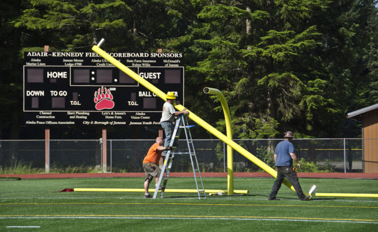 Assembling the goal post starts with the horizontal crossbar which sits 10 feet off the ground.