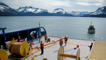 Trainees with Royal Dutch Shell learn to deploy oil spill booms in the waters near the port of Valdez in Alaska. The company is training about 200 spill responders. (Photo by Richard Harris/NPR)