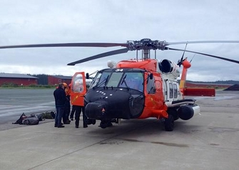 Juneau Mountain Rescue personnel and an Air Station Sitka MH-60 Jayhawk helicopter crew prepare to depart Juneau Thursday en route to the crash site of a downed small plane reported overdue on a flight from Juneau to Gustavus. (Photo Courtesy Scott Giard/U.S. Coast Guard)