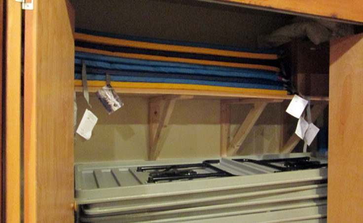 Sleeping pads for the dorms are stored in a closet.