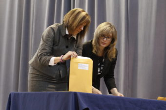 Division of Elections Director Gail Fenumiai prepares an envelope with Election Coordinator Lauri Wilson to be sealed by electors. (Photo by Annie Bartholomew/KTOO)