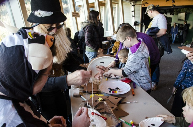 Dozens of families gathered today for the annual Fall Family Fun Fest at the Mendenhall Glacier Visitor Center.The mask making table was quite busy with costumed children making masks of their favorite animals.