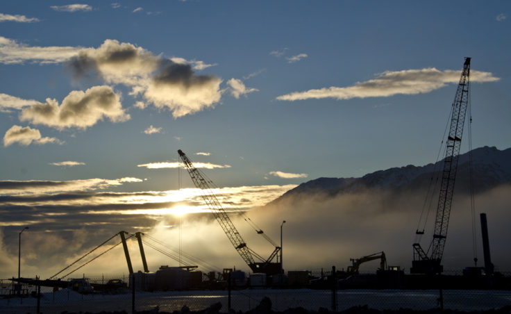 A barge with a crane is in place at Coast Guard Station Juneau to install a mooring dolphin.