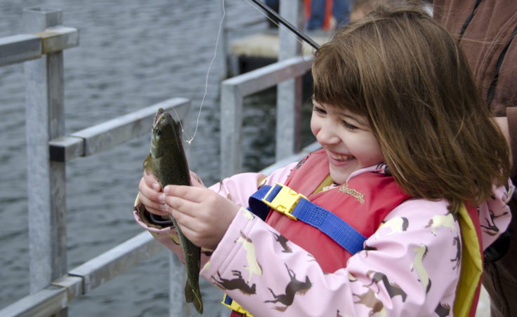 Dozens of families made their way to Twin Lakes on Saturday, June 2, for Family Fishing Day. Cheyenne Herline, 5, shows off her first fish.