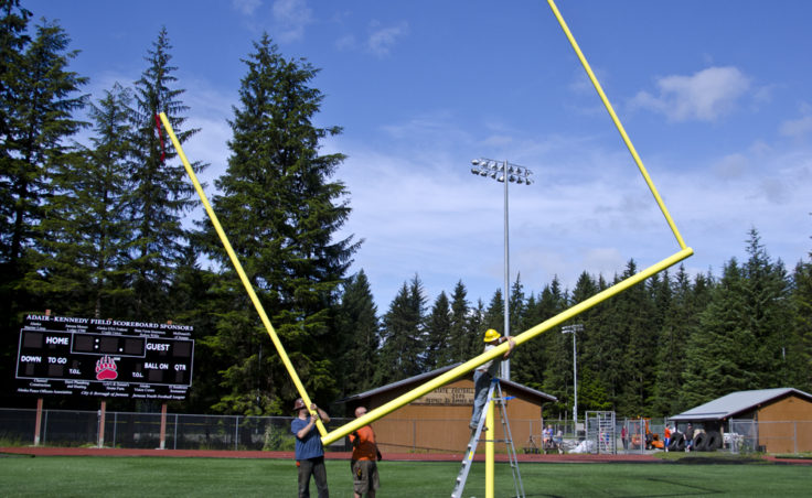 The goal posts are up and games will soon be played on the new turf field at Adair Kennedy Park in Juneau's Mendenhall Valley. After the uprights are added the crossbar is rotated back to a level position.