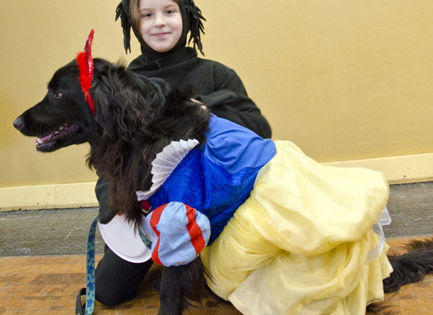 "Tallulah, 8, and her friend Maximo Wagglebottom, won the costume contest. ""He doesn't like wearing it,"" says Tallulah about the dress Maximo wore. ""He was biting it."" Ten dogs and one cat took to the stage last Saturday for the Pawsitively Fabulous Pet Fashion Show."