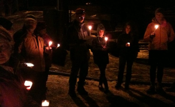 About two dozen people gathered near the Capital School and Terry Miller Legislative Office building on Dec. 16 for a candlelight vigil to remember the victims of the school shooting in Newtown, Connecticut.