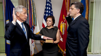New Defense Secretary Chuck Hagel, left, as he was sworn in Wednesday morning at the Pentagon. His wife, Lilibet, held the Bible. Michael L. Rhodes, the Pentagon's director of administration and management, administered the oath. MC1 Chad J. McNeeley/Office of the Secretary of Defense