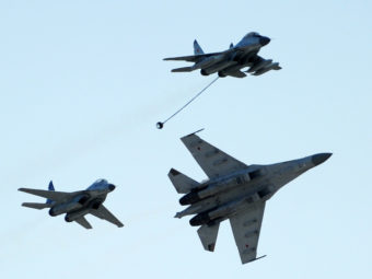 Russian MiG-29 (top), MiG-35 (left) and Su-35 (right) perform at an air show outside Moscow, in 2011. Dmitry Kostyukov/AFP/Getty Images