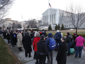 The line was long Tuesday outside the Supreme Court in Washington, D.C., as spectators came to hear the oral arguments about California's Proposition 8. Jonathan Ernst /Reuters /Landov
