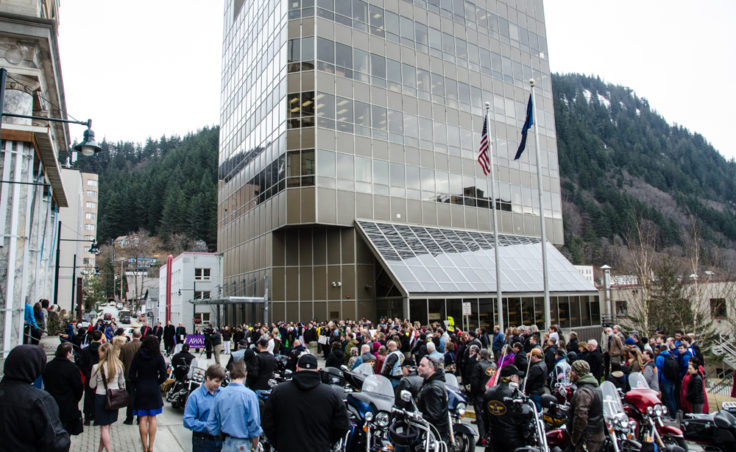 The crowd met at the Capitol steps before marching down Main Street. (Photo by Heather Bryant/KTOO)