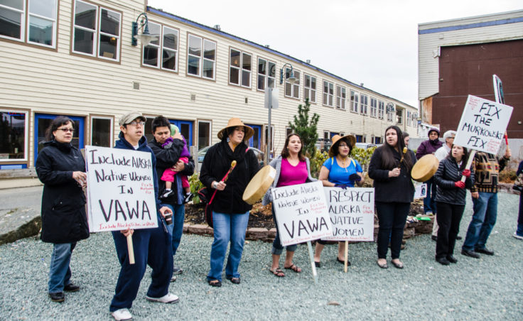 Ishmael Hope and a group of concerned people carried signs asking representatives to address issues with VAWA. (Photo by Heather Bryant/KTOO)