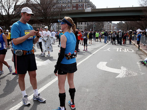 A runner using his cell phone after two bombs exploded at the Boston Marathon on Monday. Alex Trautwig/Getty Images