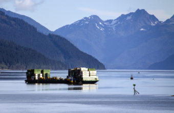 A barge departs from the Alaska Marine Lines dock in downtown Juneau.
