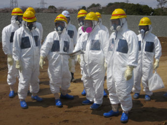 As they inspected an underground storage pool near the crippled Fukushima Daiichi nuclear power plant earlier this month, Tokyo Electric Power Co. President Naomi Hirose (4th from left) and other officials wore protective suits and masks. Radioactive water stored in some of the pits has leaked. Tokyo Electric Power Co./Reuters /Landov