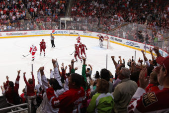 Fans cheer after Martin Hanzal of the Phoenix Coyotes scores an empty-net goal against the Detroit Red Wings in Glendale, Ariz., on April 4. Christian Petersen/Getty Images