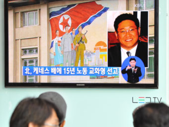 Passersby watch a local television broadcast in Seoul on Thursday showing a report on the sentencing of Kenneth Bae. Kim Jae-hwan/AFP/Getty Images