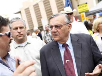 Maricopa County Sheriff Joe Arpaio (right) attends a rally for the Tea Party Express in 2010. Joshua Lott/Getty Images