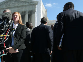 Abigail Noel Fisher, who challenged a racial component to University of Texas at Austin's admissions policy, speaks to the media outside the U.S. Supreme Court building during oral in the case in October. Mark Wilson/Getty Images