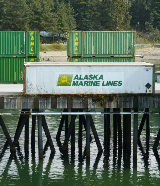 Alaska Marine Lines containers wait for loading on Yakutat's dock. AML is part of Lynden. Image by Ed Schoenfeld, CoastAlaska News.