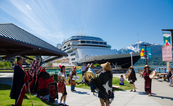 One of the speakers spoke on the recent legislation that relaxed the regulations on where cruise ships could dump waste water. (Photo by Heather Bryant/KTOO)