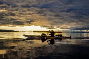 "The ""A Trip South"" team kayaks down the Inside Passage during sunset. Photo courtesy of Lia Heifitz."