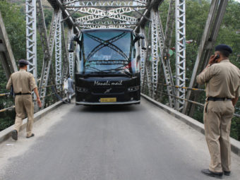 Indian police stop a tourist bus on Wednesday at a checkpoint put in place after the alleged rape of an American woman in the northern town of Manali. AFP/Getty Images