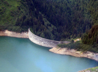 The Salmon Creek Dam, pictured here in July 2010, was built in 1914. It was the first of its kind in the world and still generates electricity for Juneau.