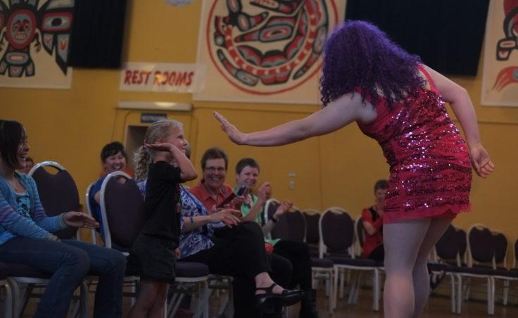 drag queen gives girl a high five