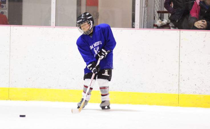 Kieren Tagsib passes the puck during during JDIA's Learn to Play event Saturday at Treadwell Ice Arena.