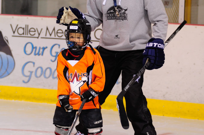 Bryan Smith works with Dylan Sowa during a passing drill drawn up by Smith at the Rocky Mountain Hockey School.