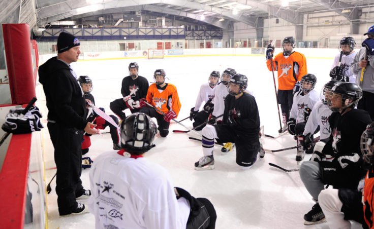 Chad Macleod addresses of players attending the five-day Rocky Mountain Hockey School camp at Treadwell Ice Arena.