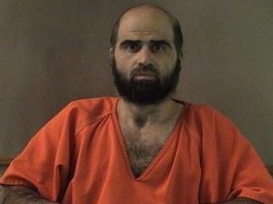 Maj. Nidal Hasan faces 13 charges of murder and 32 of attempted murder for the November 2009 shootings at Fort Hood, Texas. Reuters/Landov