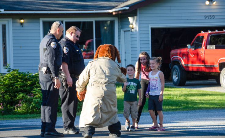 McGruff the Crime Dog greets Anne Weske and her children Drew, 4, and Abigail,7.