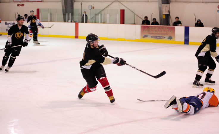 Chris Budbill of the Viking unleashes a shot against the Island Pub team from just inside the blue line.