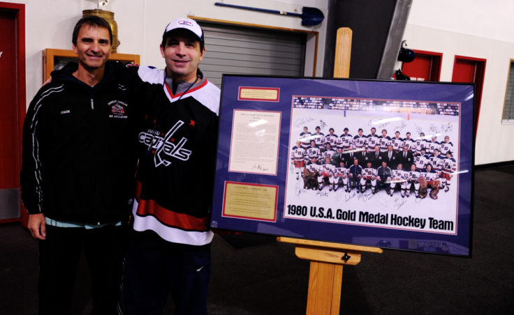 JDIA President Arnold Liebelt thanks Steve MacSwain for his two-day camp and the donation of the U.S. Olympic team photo, who Liebelt eventually had framed for permanent display at Treadwell Ice Arena.