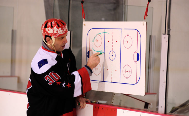 Steve MacSwain kicks off his two-day youth hockey clinic at Treadwell Ice Arena by diagramming the first activity.