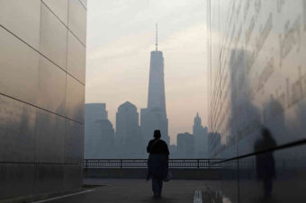 A woman looks out at One World Trade Center from inside the 9/11 Empty Sky memorial at Liberty State Park in Jersey City, N.J. on Wednesday. Americans will commemorate the 12th anniversary of the Sept. 11 attacks with solemn ceremonies and pledges to not forget the nearly 3,000 killed when hijacked jetliners crashed into the World Trade Center, the Pentagon, and a Pennsylvania field. Gary Hershorn/Reuters/Landov