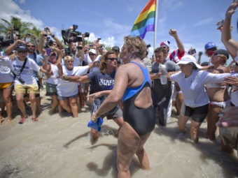 United States endurance swimmer Diana Nyad is greeted by a crowd as she walks on to the Key West, Fla., shore today. J Pat Carter/AP