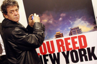 Musician Lou Reed, for decades a rock icon, died Sunday at age 71. In 2006, he took a picture of an ad for his own photo exhibit in Naples. AFP/AFP/Getty Images