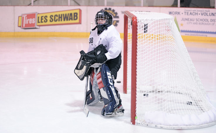 Zack Stagg gets set during a drill where shots could be coming from any direction as the puck gets passed among a group of shooters during JDIA's skills development camp that attracted nine goalies.