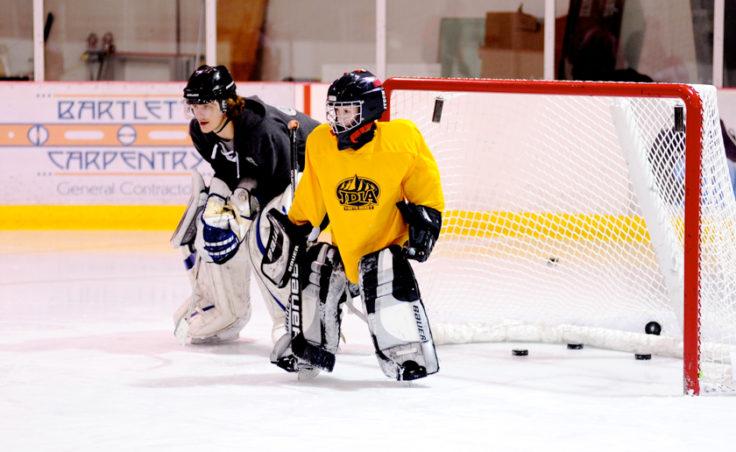 Goaltender Coach Matt Noreen works alongside Jax White during JDIA's skills development camp that attracted nine goalies.