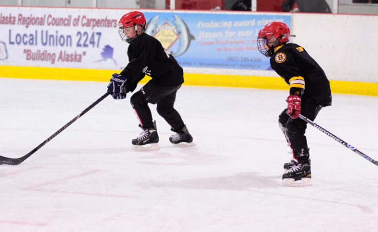 Gage Cooney, right, chases down teammate Gabe Miller during a drill at JDIA's skills development camp.